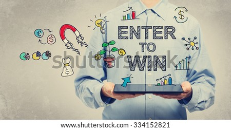 Enter to Win concept with young man holding a tablet computer  - stock photo