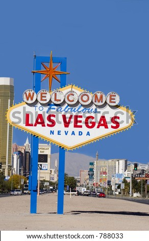 Entering Las Vegas  - Strip and mountains in background against blue sky - stock photo