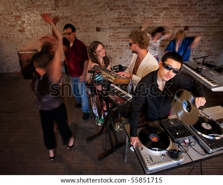 Entertaining and dancing at a 1970s Disco Music Party - stock photo
