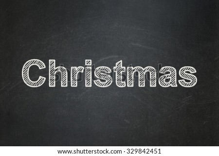 Entertainment, concept: text Christmas on Black chalkboard background - stock photo