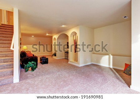 Entertainment room with niche in the wall, couch and ottoman - stock photo