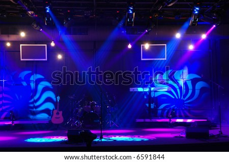 Entertainment stage with lights and musical instruments.