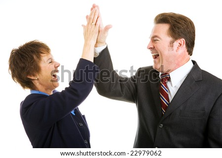 Enthusiastic business partners giving each other a high five.  Isolated on white. - stock photo
