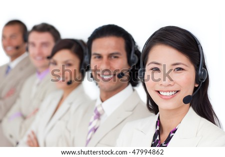 Enthusiastic business team lining up with headset on against a white background - stock photo