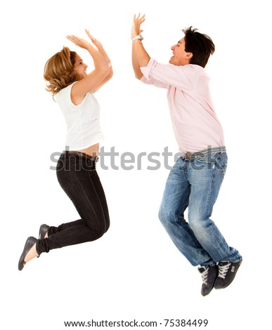 Enthusiastic couple jumping and making a high-five isolated - stock photo