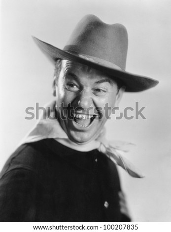 Enthusiastic cowboy - stock photo