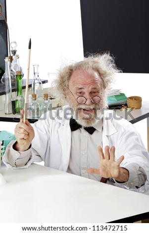 Enthusiastic eccentric senior scientist in his lab points up excited about ideas. High key, vertical, copy space. - stock photo