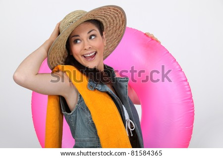 Enthusiastic girl ready for the  beach - stock photo