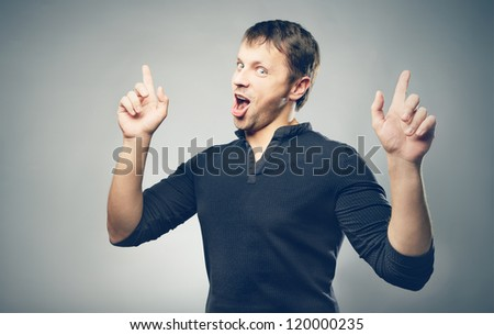 Enthusiastic Man on gray background - stock photo