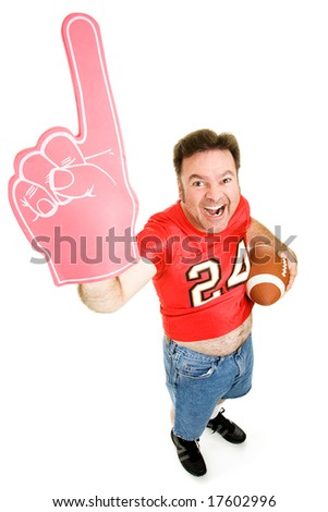 Enthusiastic middle aged football fan holding a football and wearing a foam finger.  Full body isolated on white.