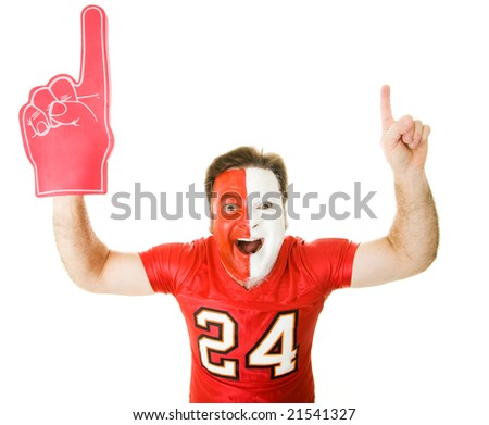 Enthusiastic sports fan with foam finger raises his arms in the Number One gesture.  Isolated on whit. - stock photo