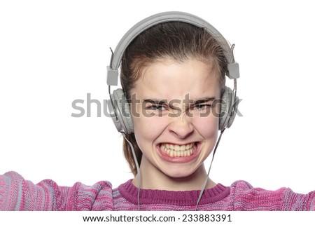 enthusiastic teenage girl with headphones, isolated on white - stock photo
