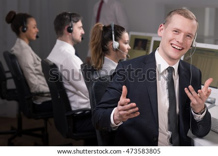 Enthusiastic young man working in call center