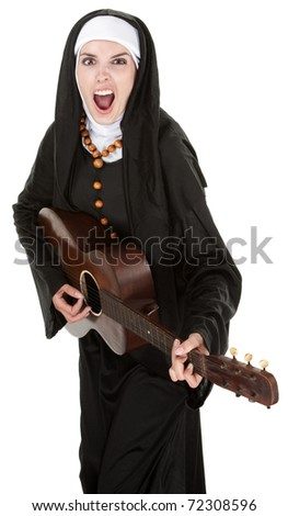 Enthustiatic Nun singing out loud while playing a guitar - stock photo