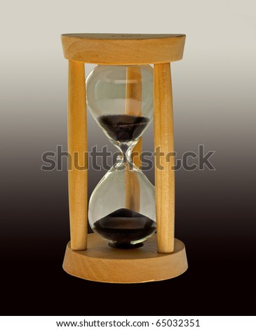 Entire view of a wooden hourglass with black sands