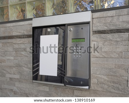 Entrance access keypad and intercom to an apartment building - stock photo