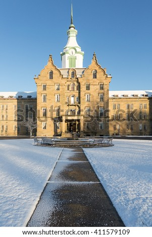 Entrance and clock tower of Trans-Allegheny Lunatic Asylum which is a Kirkbride Psychiatric hospital  in Weston, West Virginia, USA - stock photo