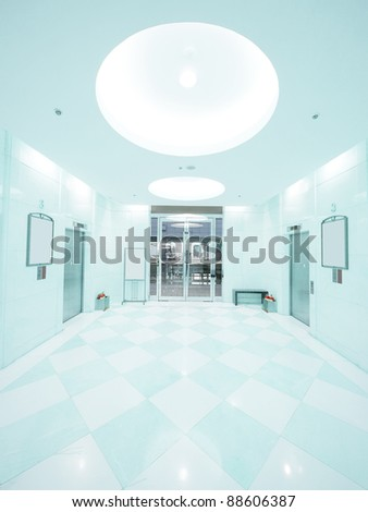 Entrance and elevator waiting room - stock photo