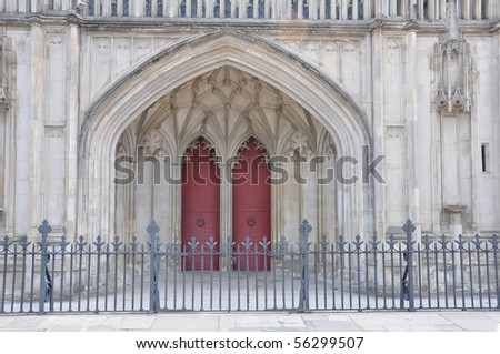 Entrance and old doors of Winchester Cathedral Uk - stock photo