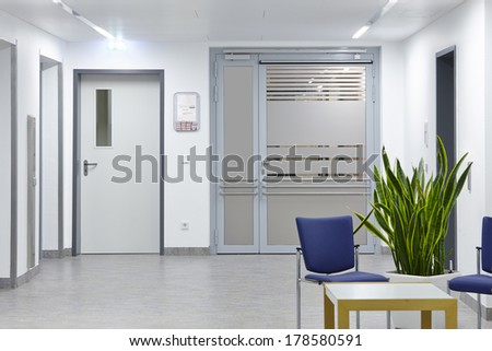 Entrance door in the hospital with furniture - stock photo