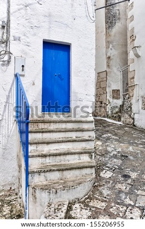 Entrance door of a residential structure in a street in Ostuni's old town, in Apulia. Italy.