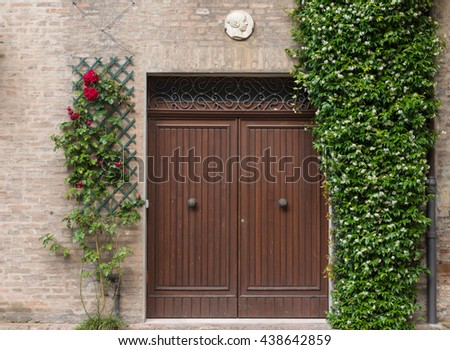 Entrance door of an an old house in Ferrara Italy