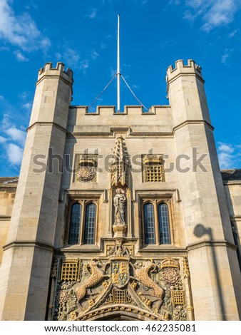 Entrance door of the First Court in Cambridge, England, under cloudy blue sky