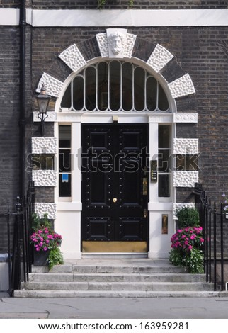 Entrance doorway to 18th century Georgian townhouse in London, UK. - stock photo