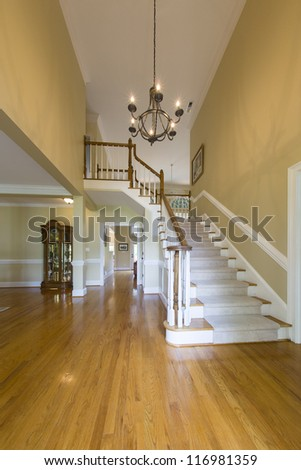 Entrance foyer with staircase - stock photo