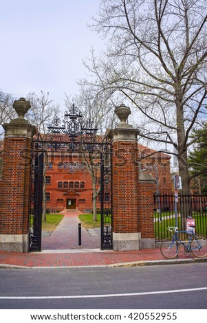 Entrance gate and East facade of Sever Hall in Harvard Yard in Harvard University in Cambridge, Massachusetts, MA, USA. It is used as the library, lecture hall and classroom for different courses. - stock photo