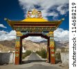Entrance gate in a Buddhist monastery. Ladakh, India - stock photo