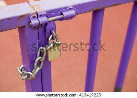 Entrance Gate to the Stadium Locked with Padlock and chain, Selective focus - stock photo
