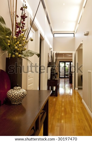 Entrance hall of new showcase home, with polished floorboards and elegant decor. - stock photo