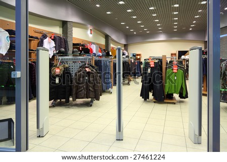 Entrance in clothes section in store, focus on gate - stock photo