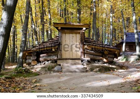 Entrance in Koliba, wooden temporary housing in Zakarpattia - stock photo