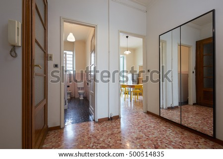 Entrance in normal apartment with tiled floor