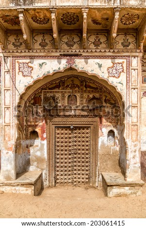 entrance into old house in India. With wooden door and ornaments