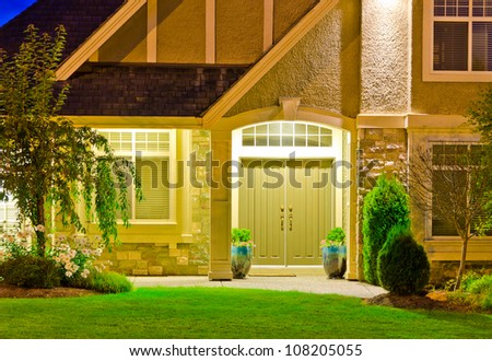 Entrance of a big luxury house at dusk, night in suburbs of Vancouver, Canada - stock photo
