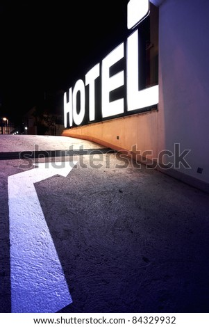 Entrance of a hotel, light letters. - stock photo