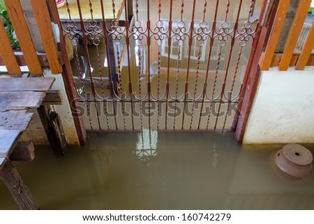 entrance of a House fully flooded. - stock photo