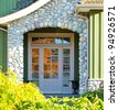 Entrance of a house in a bright sunny day.. - stock photo