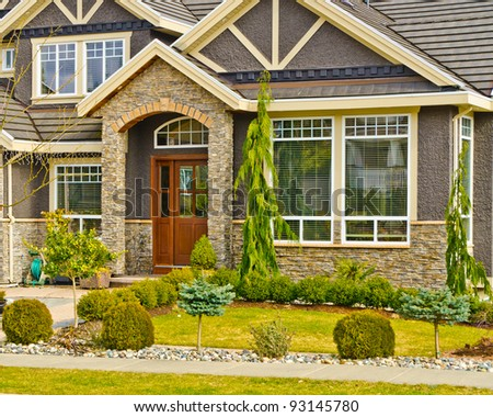 Entrance of a house with nice outdoor landscape - stock photo