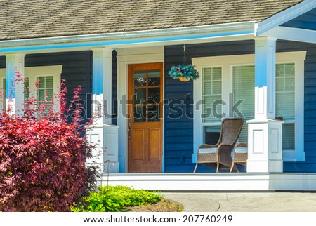 Entrance of a house with nicely made, organized front porch. - stock photo