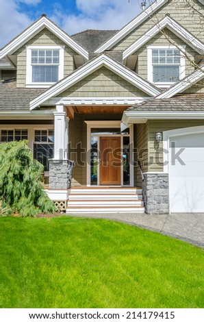 Entrance of a luxury house on a bright, sunny day. - stock photo
