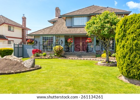 Entrance of a luxury house with a patio on a bright, sunny day. Home exterior. - stock photo
