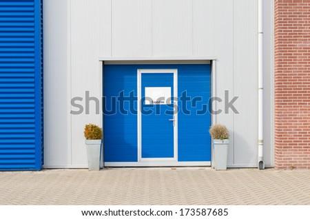entrance of a modern blue warehouse - stock photo