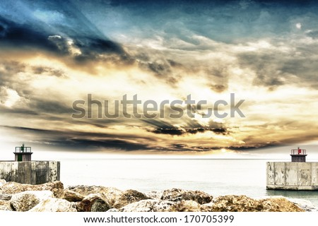 Entrance of harbor with beautiful sky. - stock photo
