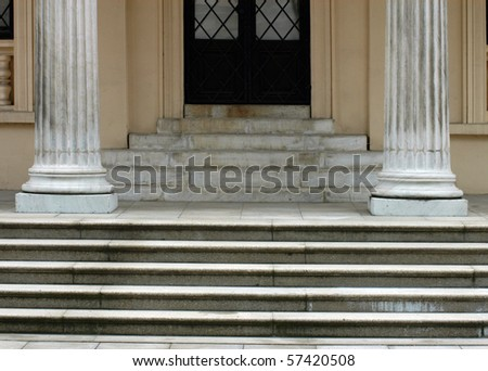 Entrance of historical building with steps and columns - stock photo