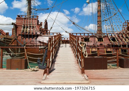 Entrance of pirate ship in park on cloudy background. - stock photo