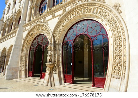 Entrance of Rossio Train Station. Rossio Station is Neo-Manueline building built in 19th century at Praca dos Restauradores (Restauradores Square) in Lisbon, Portugal.  - stock photo